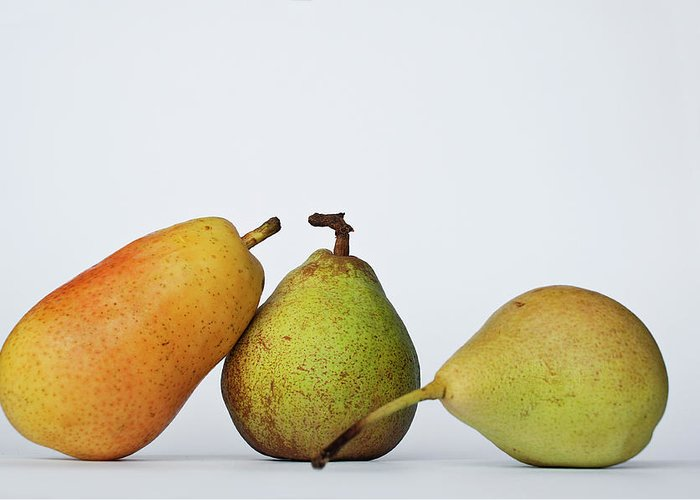 Healthy Eating Greeting Card featuring the photograph Three Diferent Pears Isolated On Grey by Irantzu Arbaizagoitia Photography