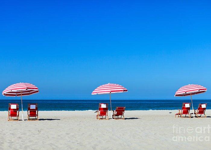Santa Monica Greeting Card featuring the photograph Three Sun Umbrellas At Santa Monica by Blueorange Studio
