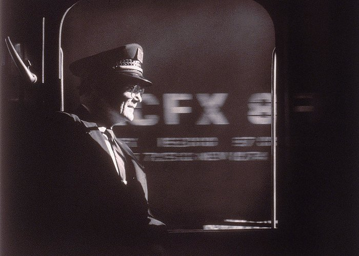 Working Greeting Card featuring the photograph Train Conductor Looking Out Of Window by John Coletti