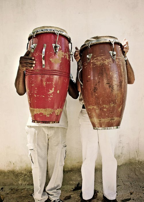 Hiding Greeting Card featuring the photograph Two Men Holding Bongos In Front Of by Holly Wilmeth