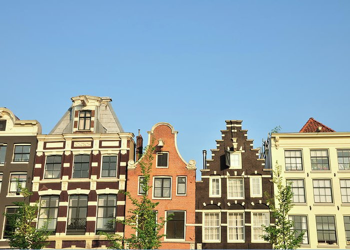 In A Row Greeting Card featuring the photograph Typical Canal Houses, Amsterdam, The by Gorazdbertalanic