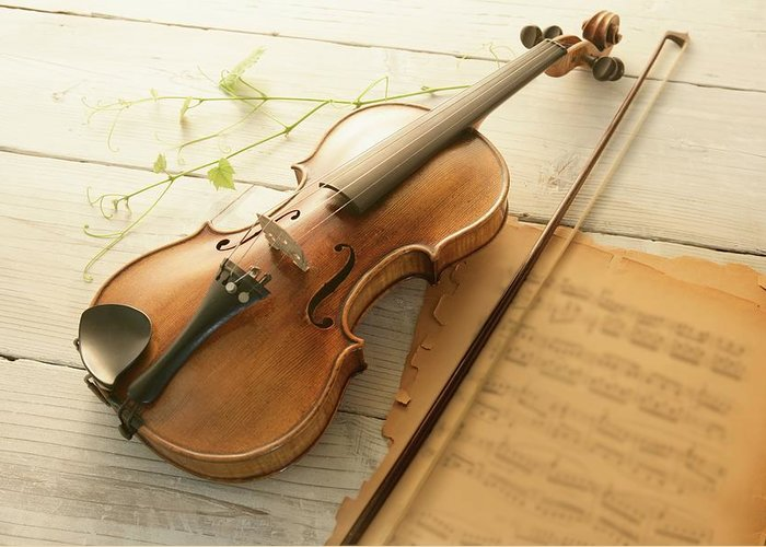 Sheet Music Greeting Card featuring the photograph Violin And Music Sheet by Image Work/amanaimagesrf