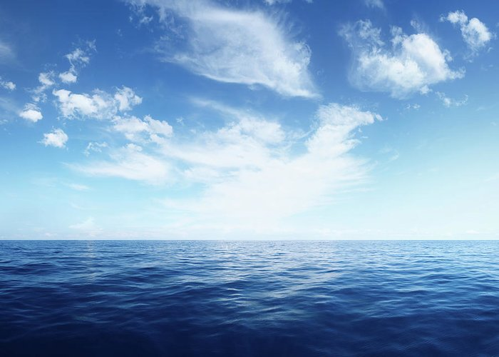 Scenics Greeting Card featuring the photograph Wispy Clouds Over Deep Blue Ocean by Turnervisual