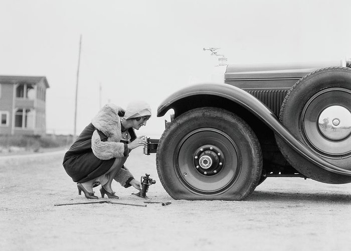 People Greeting Card featuring the photograph Woman Changing Flat Tire On Car by H. Armstrong Roberts