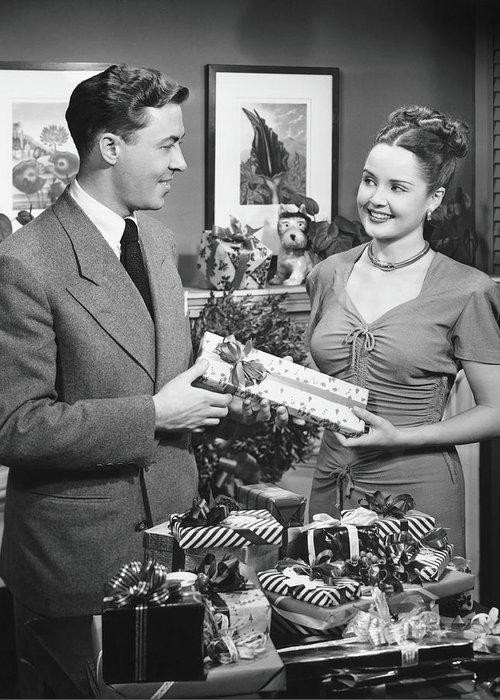 Heterosexual Couple Greeting Card featuring the photograph Woman Giving Gift To Man, B&w by George Marks