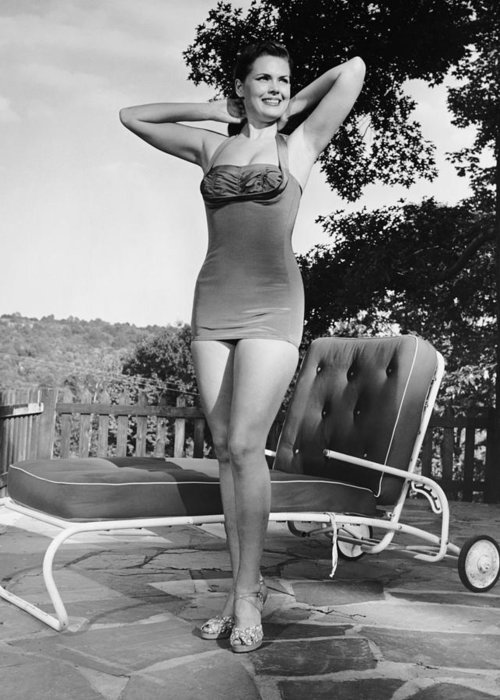 People Greeting Card featuring the photograph Woman In Bathing Suit Outdoors by George Marks