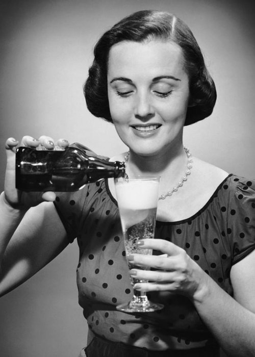 People Greeting Card featuring the photograph Woman Pouring Alcoholic Beverage by George Marks