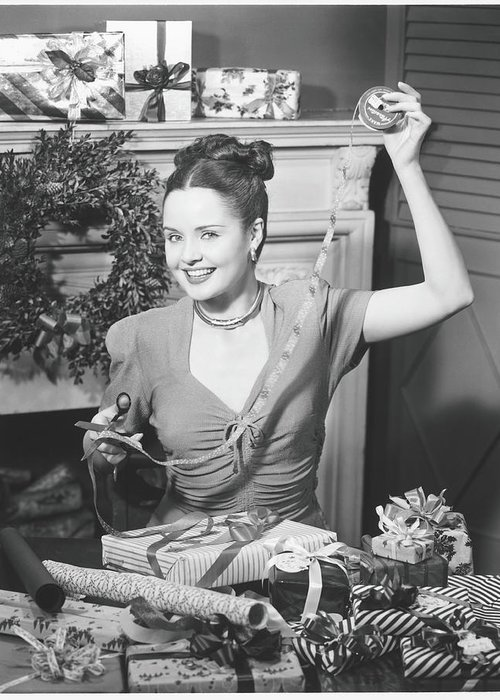Human Arm Greeting Card featuring the photograph Woman Wrapping Christmas Presents In by George Marks