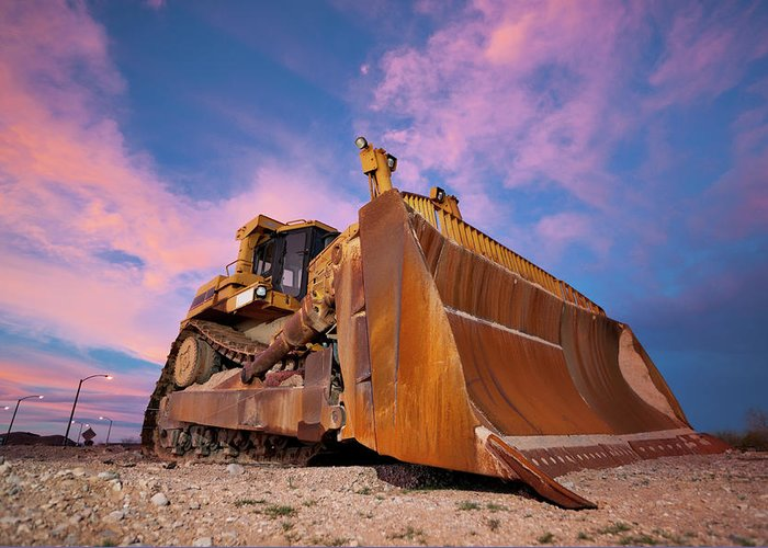 Toughness Greeting Card featuring the photograph Yellow Bulldozer Working At Sunset by Wesvandinter