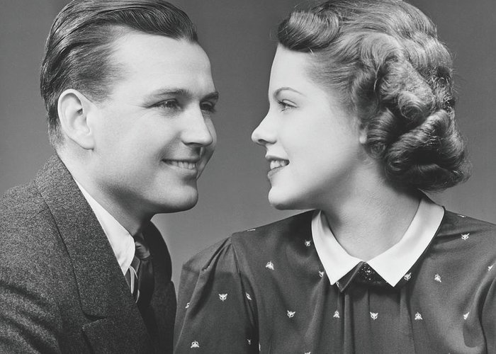 Young Men Greeting Card featuring the photograph Young Couple Looking In Eyes In Studio by George Marks