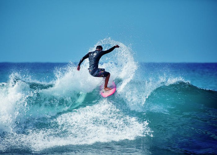 Young Men Greeting Card featuring the photograph Young Male Surfer Surfing In The Water by Yinyang