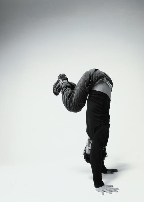Youth Culture Greeting Card featuring the photograph Young Man Breakdancing B&w by Karen Moskowitz