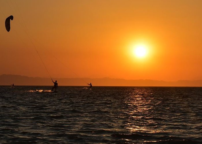 Kitesurfing Greeting Card featuring the photograph Red sea sunset by Luca Lautenschlaeger