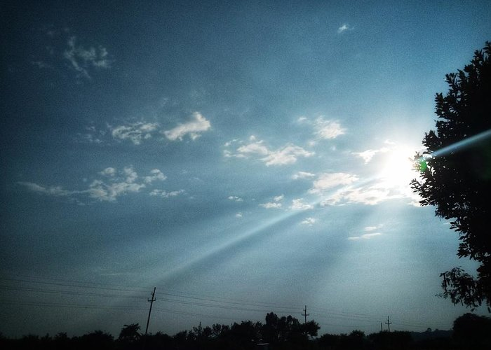 Sky Greeting Card featuring the photograph Striking rays by Yvonne's Ogolla