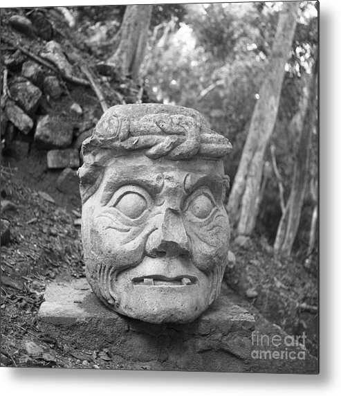 Old Man Of Copan Metal Print featuring the photograph Old Man Of Copan Sculpture, Also Known As The Pauahtun Head From by The Harrington Collection