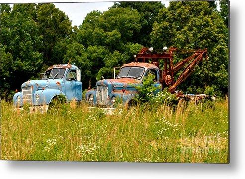 Missouri Metal Print featuring the photograph Route 66 Disney Truck Replicas by Pam Schmitt