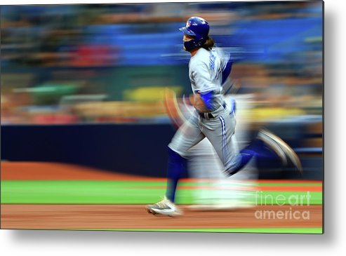 People Metal Print featuring the photograph Toronto Blue Jays V Tampa Bay Rays by Mike Ehrmann