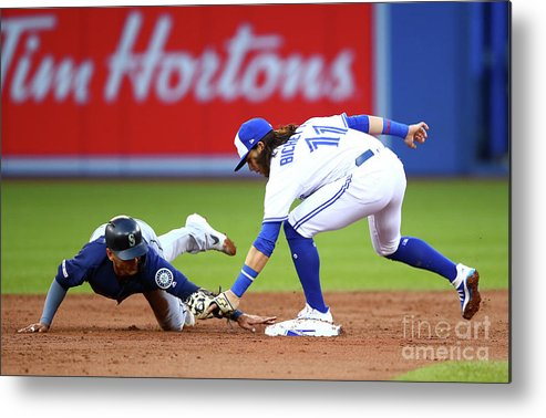 People Metal Print featuring the photograph Seattle Mariners V Toronto Blue Jays by Vaughn Ridley