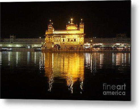 Amritsar Metal Print featuring the photograph The Golden Temple At Amritsar At Night by Robert Preston