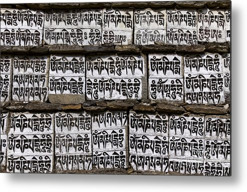 Mani Metal Print featuring the photograph Detail Of A Carved Mani Stone In The Everest Region Of Nepal by Robert Preston