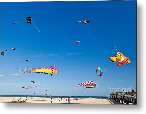 Flying Kites At St Augustine Beach Pier Metal Print featuring the photograph Flying Kites At St Augustine Beach Pier by Michelle Constantine