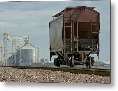 Cement Metal Print featuring the photograph A Lone Grain Hopper Stands Idle On The Tracks by Mark Hendrickson