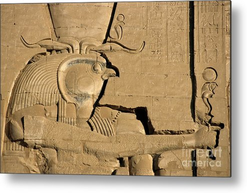 Africa Metal Print featuring the photograph The Ancient Egyptian God Horus Sculpted On The Wall Of The First Pylon At The Temple Of Edfu by Sami Sarkis