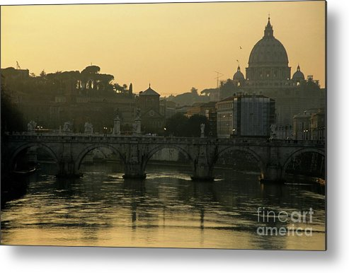 Architectural Metal Print featuring the photograph The Sant Angelo Bridge And The Papal Basilica Of Saint Peter At Sunset In Vatican City by Sami Sarkis
