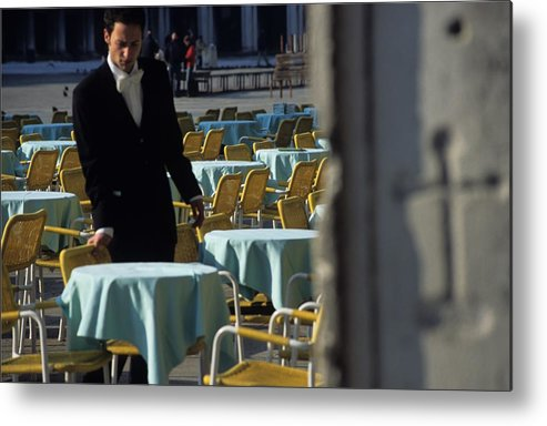 Venice Metal Print featuring the photograph Waiter Preparing For The Day In Piazza San Marco In Venice by Michael Henderson
