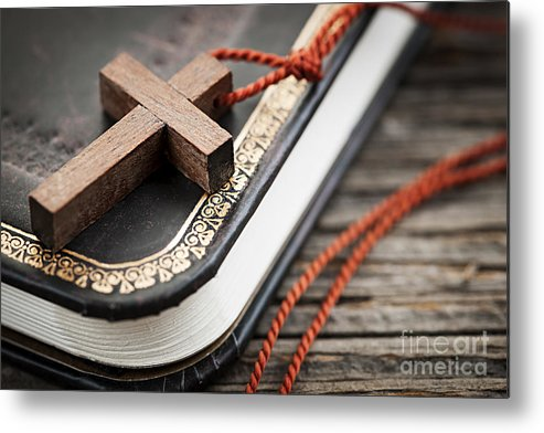 Cross Metal Print featuring the photograph Cross On Bible by Elena Elisseeva