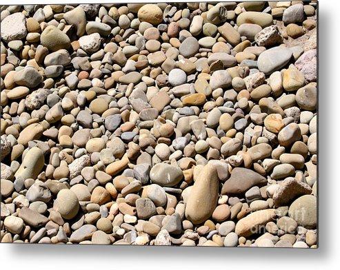 Stone Metal Print featuring the photograph River Rocks Pebbles by Henrik Lehnerer