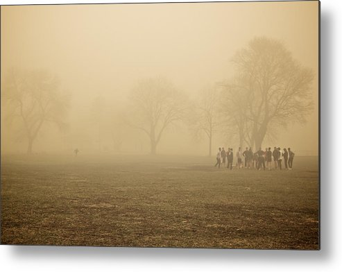 Man Metal Print featuring the photograph Running Back by Josh Eral
