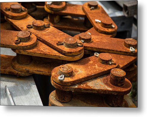 Rusty Links Metal Print featuring the photograph Rusty Links by Karol Livote