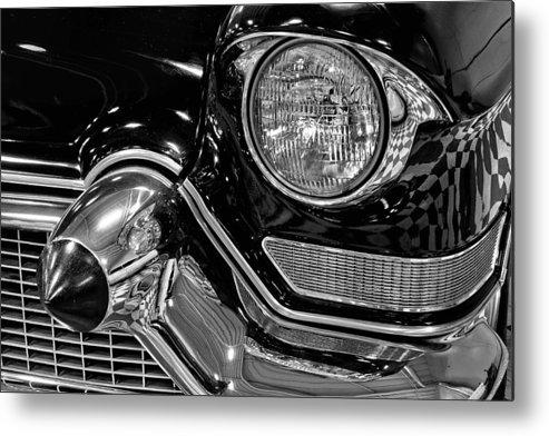 1957 Metal Print featuring the photograph 1957 Cadillac Coupe De Ville Headlight by Michael Gordon
