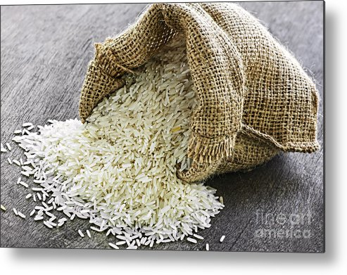 Rice Metal Print featuring the photograph Long Grain Rice In Burlap Sack by Elena Elisseeva