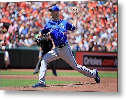 American League Baseball Metal Print featuring the photograph Toronto Blue Jays V Baltimore Orioles by Rob Carr