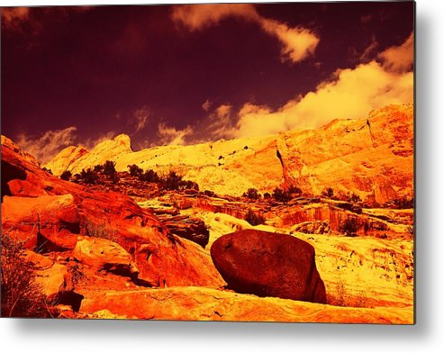 Metal Print featuring the photograph A Black Rock And Blue Sky by Jeff Swan