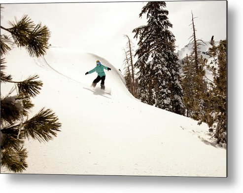 California Metal Print featuring the photograph A Female Snowboarder Lays Out Some by Kyle Sparks