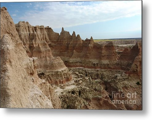 Badlands Metal Print featuring the photograph A Straight Drop by Deanna Cagle