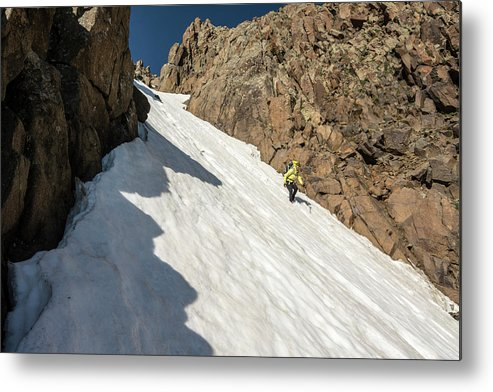 Low Angle View Metal Print featuring the photograph A Woman Descending A Snow Slope While by Kennan Harvey