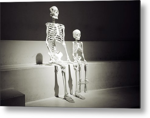 Adult Child Skeleton Sitting Together As If Waiting For Something Metal  Print