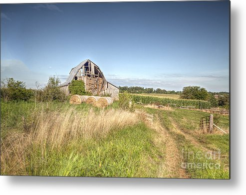 2013 Metal Print featuring the photograph Barn In A Field With Hay Bales by Larry Braun