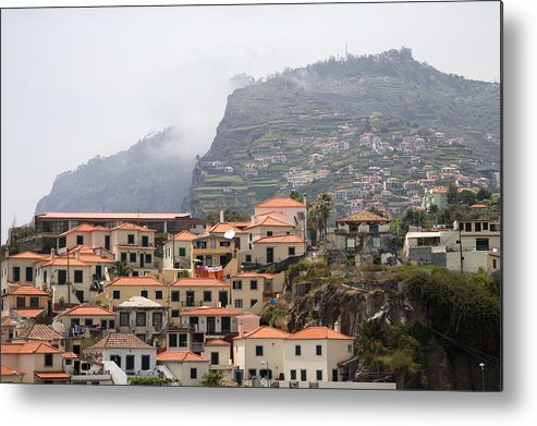 Horizontal Mist Misty Cable Car Outdoor Tourist Tours View Spectacular Vacation Holiday Atlantic Ocean Portuguese Sea Cliff Steep Escarpment Look Out Point Panoramic Coast Coastline Waves Exterior Landscape Mountains Rocks Mountainous Calm Water Summer Seashore Color Color Daytime Outdoor Nobody Houses Red Roofs Village Hillside Slope Metal Print featuring the photograph Cabo Girao Madeira Portugal by Jim Wallace
