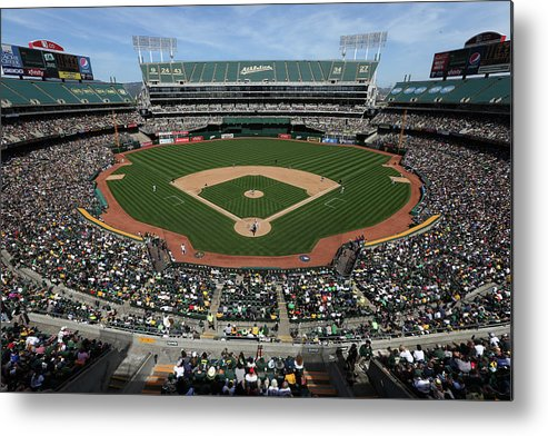 American League Baseball Metal Print featuring the photograph Detroit Tigers Vs. Oakland Athletics by Brad Mangin