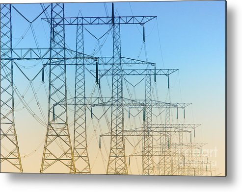 Electricity Metal Print featuring the photograph Electricity Pylons Standing In A Row by Nick Biemans