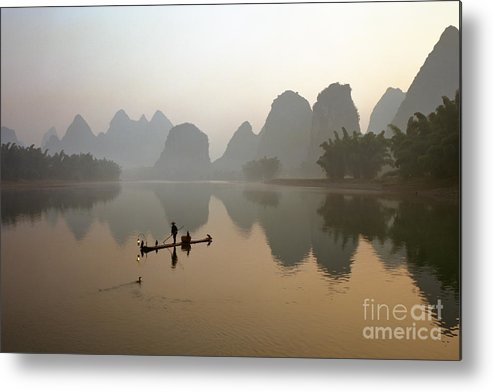 Bamboo Metal Print featuring the photograph Fishing With Cormorant On Li River by King Wu