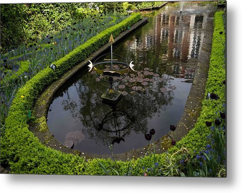 Fountain Metal Print featuring the photograph In The Heart Of Amsterdam Hidden Tranquility by Georgia Mizuleva