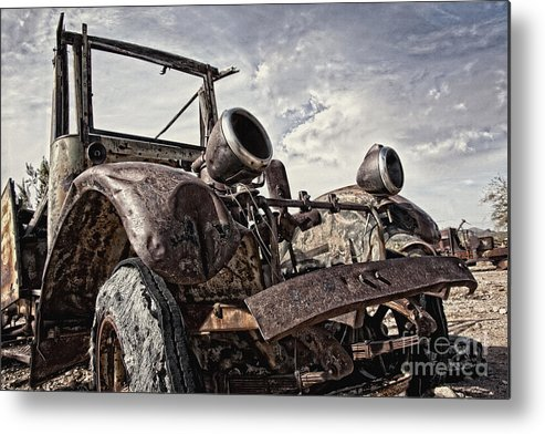 Old Truck Metal Print featuring the photograph Junk Yard Sentinel Stands by Lee Craig
