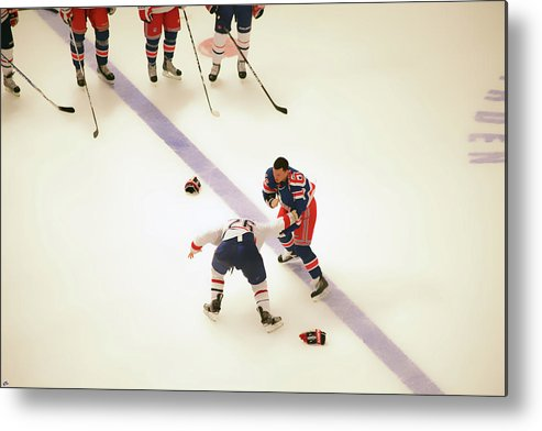 Hockey Metal Print featuring the photograph One Two Punch by Karol Livote