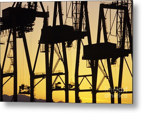 Load Metal Print featuring the photograph Port Of Seattle Cranes Silhouetted by Jim Corwin